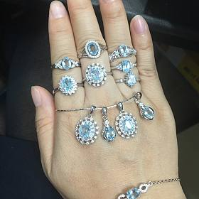 银镶彩宝一大堆—天空蓝托帕石套装、石榴石套装