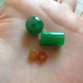 出一个翡翠阳绿桶珠