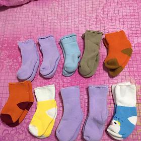 打包一堆宝宝袜子吃饭兜湿巾鞋子