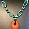 小珠绿松编了个古典的蜜蜡项,特别的感觉。还配了个手串哟!