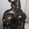 请民间高高手帮助一下,看看这木雕是什材质,叫什么人物,大概是什么年代,它的价...