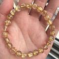 各位老师们,帮忙看下这个黄发晶还是钛晶手链,大概值几个银子,谢谢!