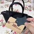 买了一个小众包包,康龙!简单的饺子包包…
