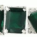 请行家帮忙看下这个绿宝石,为什么颜色这么暗,是祖母绿吗,大概能值多少钱